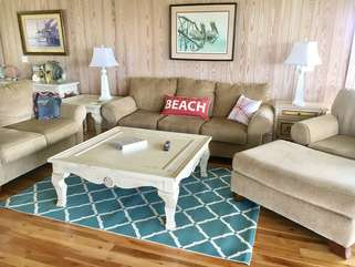 Settle into the comfortable sofa and chairs to watch TV or talk.