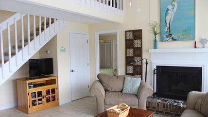 Cathedral ceilings, tile flooring & an open floor plan create an inviting space.
