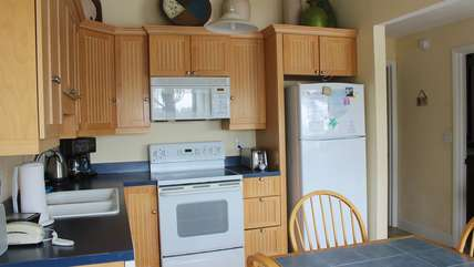 The cabinets are well stocked with all you will need to create vacation meals.