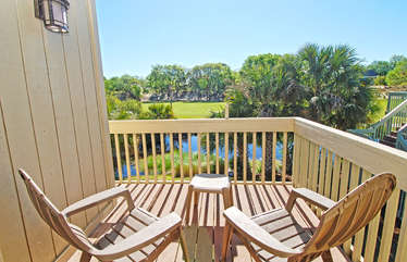 Watch the golfers while relaxing on the chairs on the private deck off the master bedroom.
