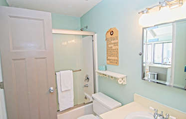 The full bath has a shower/tub and is also accessible from the hall.