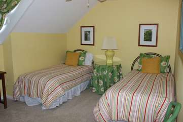 The 3rd bedroom has two twin beds and a vaulted ceiling.