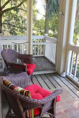 Enjoy coffee on this screened porch.