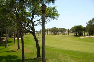 Watch the golfers from tee to green while sipping your coffee.