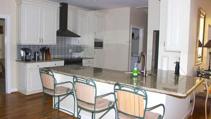 The remodeled kitchen is steps from the living room.