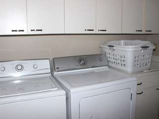 Off the hall is a laundry room with a full size washer and dryer.