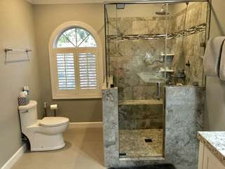 Gorgeous tiled shower, new flooring and toilet complete the master bathroom remodel.