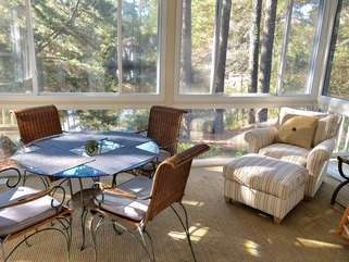 Step out to the sun room to read, watch nature, or dine at the table.