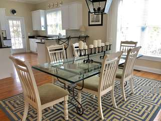 The dining area has a table that seats eight.