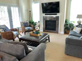 The living area has a large HDTV with stereo sound and a fireplace.