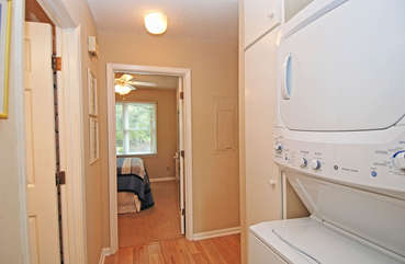The first floor laundry nook is convenient for washing away the sand.