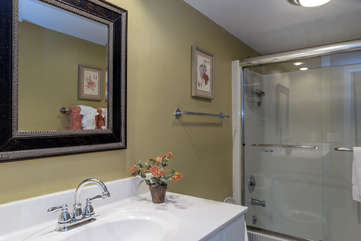 The renovated master bathroom has a large vanity.