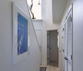 Leave the Master bedroom, and head down the hall towards the Guest bedroom