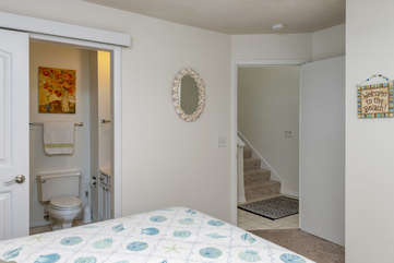 Second bedroom has two large closets with a dresser. This bathroom has an updated barn door too!