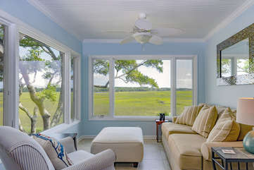 The sunroom is a great place to read a book, watch the changing tides, and see wildlife like egrets, deer, raccoons, and hopefully a dolphin swimming up the creek at high tide!