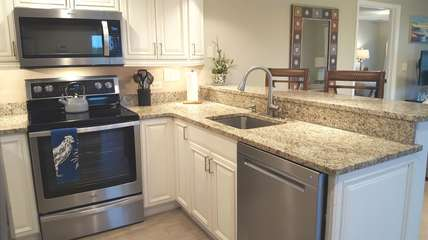 Fully equipped kitchen with all new appliances & coffee maker