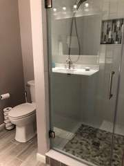 Newly remodeled master bathroom with tiled shower!