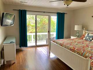 Hardwood flooring throughout the house, mounted HDTV, plenty of dresser space for your clothes in the master bedroom.  Sliding doors lead to a private deck.