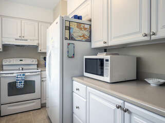 The fully equipped kitchen has new counters, and raised panel cabinets.