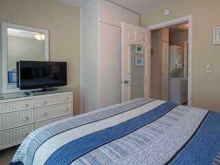 The bedroom has ample room for storage, with a dresser and closet.