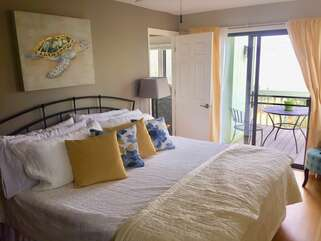 Master bedroom opens on to private deck overlooking the marsh