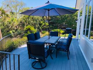 The deck has a table for 6, a gas grill, & great views.