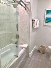 SHower/tub combination in the downstairs bathroom shared by Bedroom 1 and 2.