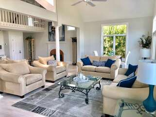 Plenty of seating for everyone to enjoy a movie at the end of the day in the open living room.