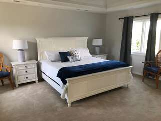 A new king bed is in the master bedroom.