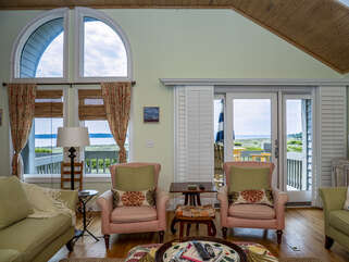 .The living room offers panoramic views of the ocean and Edisto River.