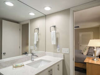This beautifully remodeled full bathroom with walk-in shower is off the master bedroom.