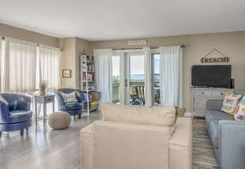 Curl up and watch tv or gaze out the sliding doors to the beach.