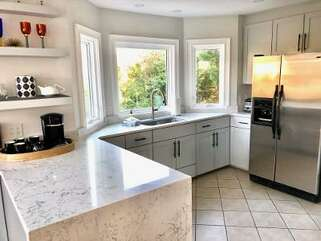 Kitchen remodeled in 2020 with marble countertops, new cabinets!
