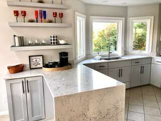 Waterfall marble countertops over new cabinets