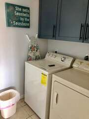 The laundry room is off the kitchen.