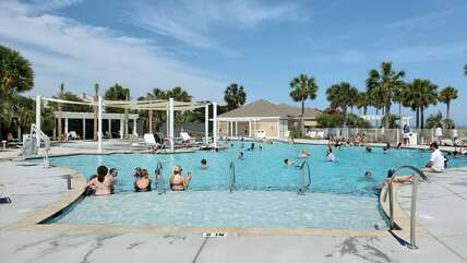 The stunning pool is one of the numerous upgraded Beach Club amenities
