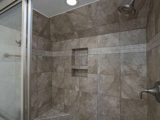 Renovated walk in shower.