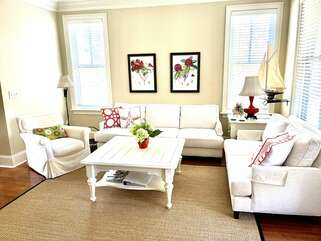 The living room is spacious and lots of light to read and enjoy.