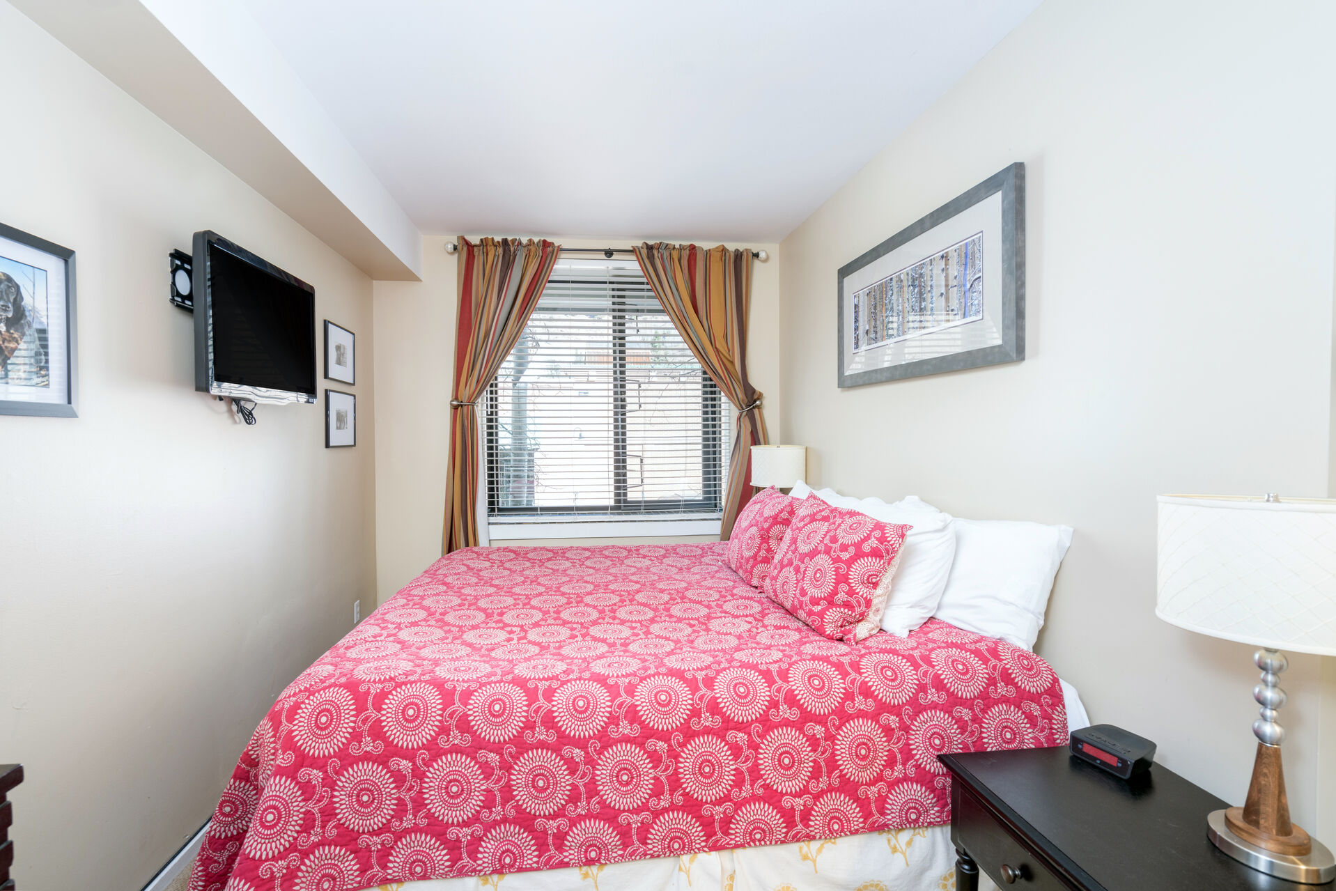 Bedroom with a king-size bed and a tv