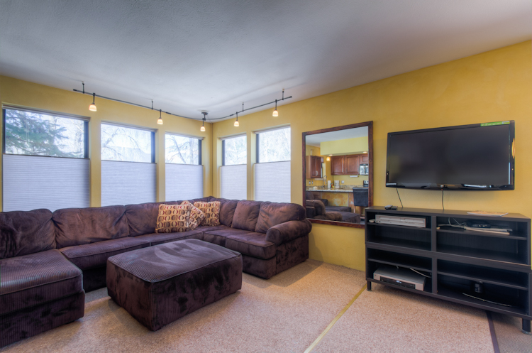 Living area with a sofa and a tv