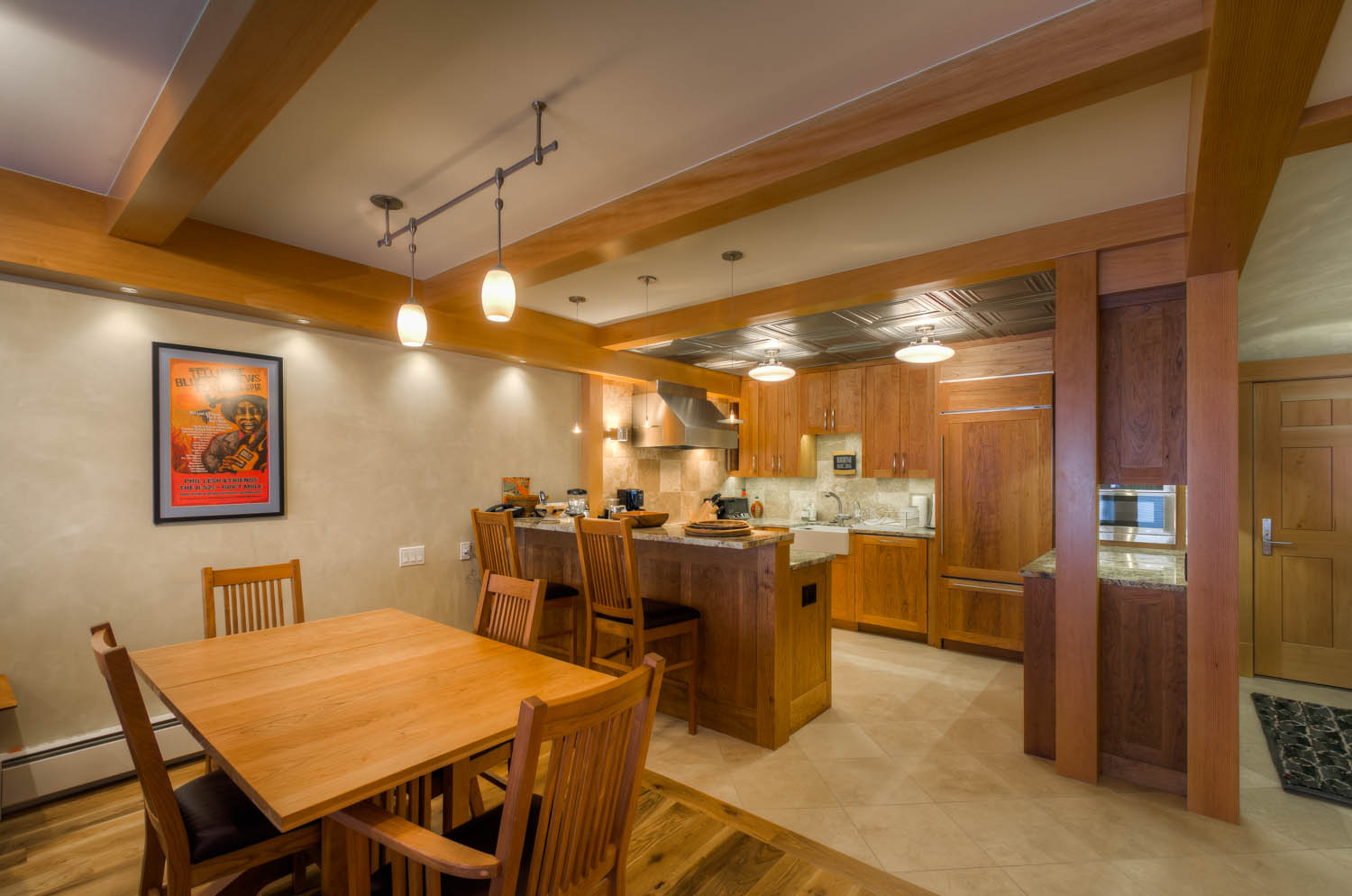 Breakfast Bar with Bar Stools, Dining Table, and Chairs