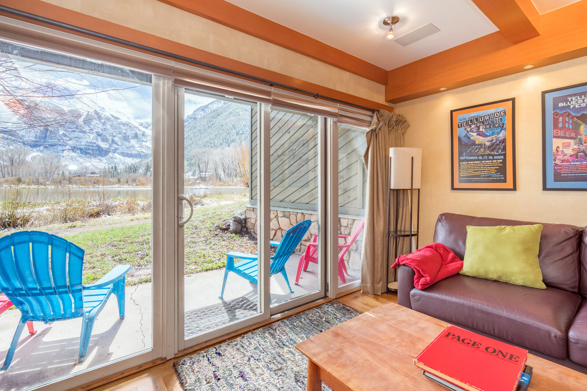 Sofa, Coffee Tabe and Sliding Doors to the Patio with Mountain Views