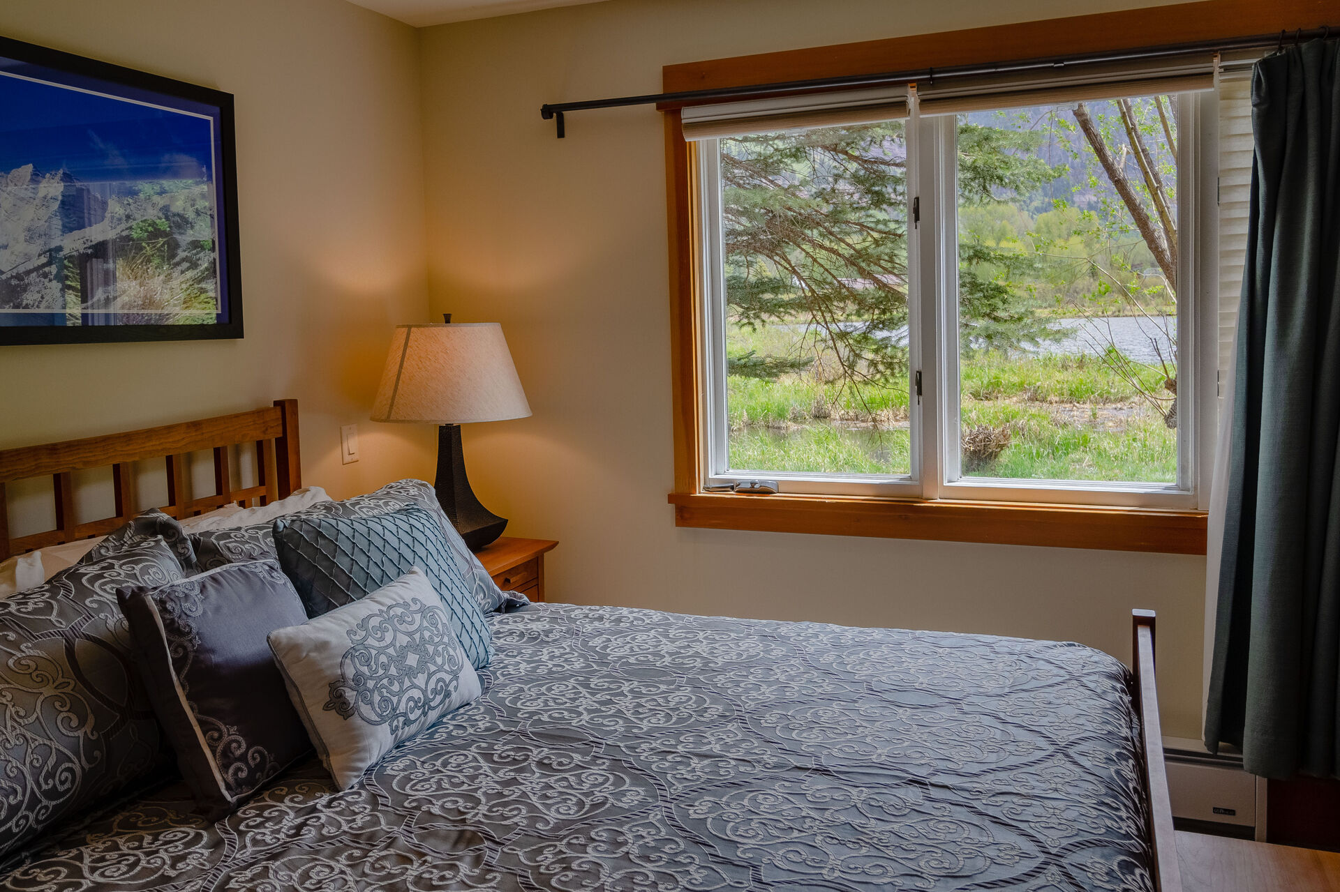 Bedroom with Large Bed and Windows with View of the Valley