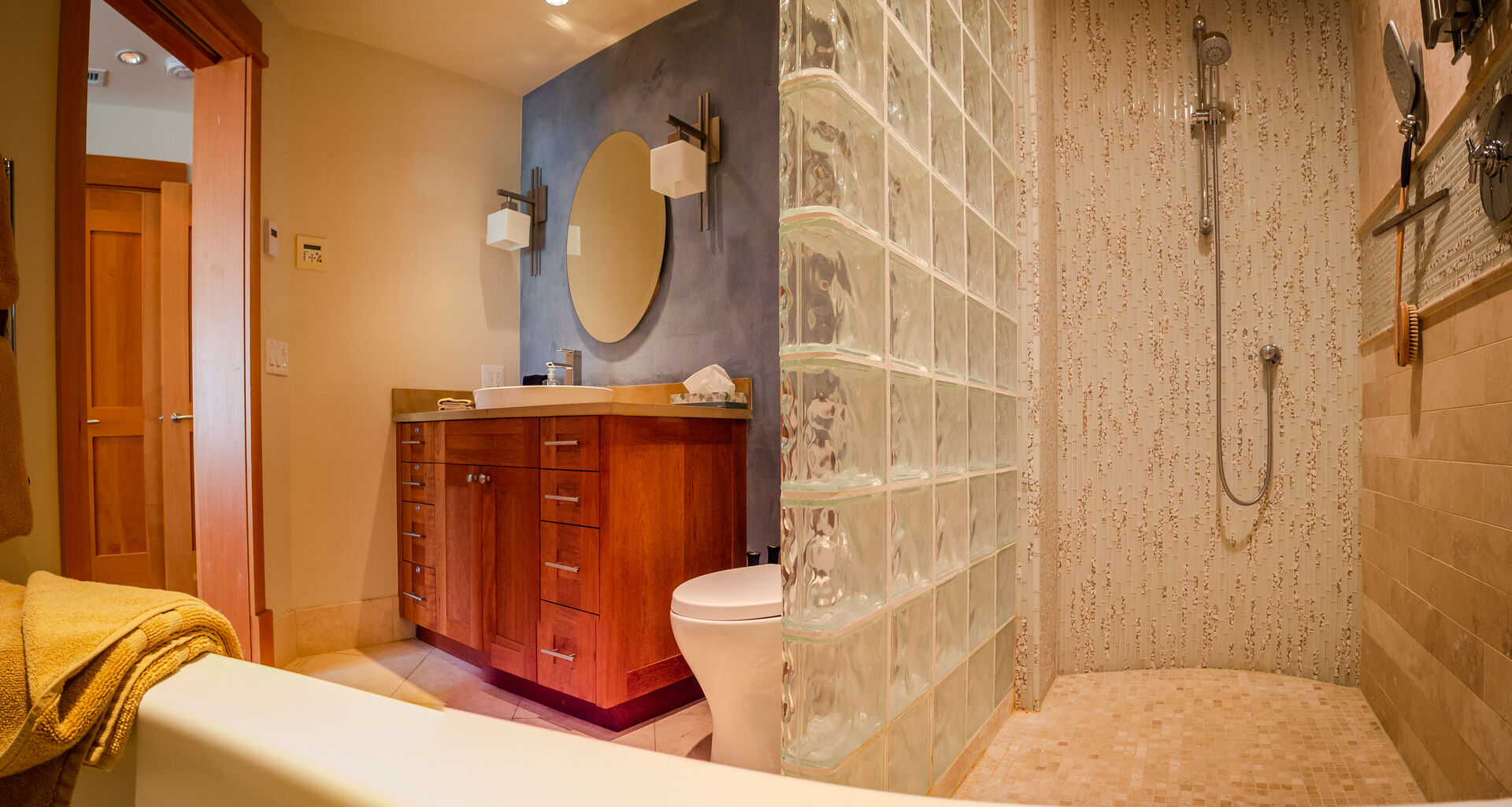 Bathroom with Single Sink, Soaking Tub, and a Shower