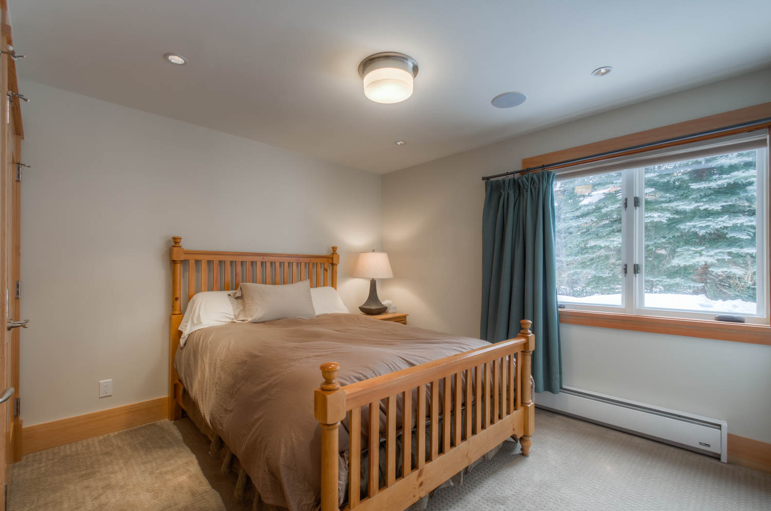 Large Bed, Nightstand, and Table Lamp
