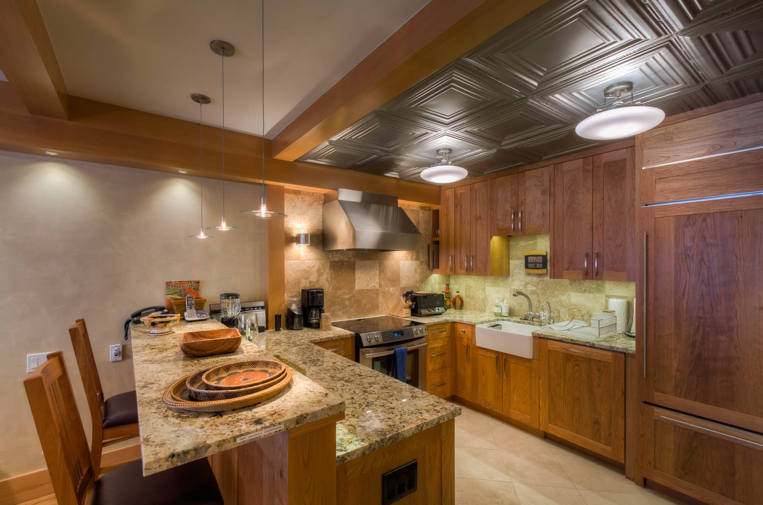 Kitchen with Breakfast Bar, Refrigerator, and Coffee Maker