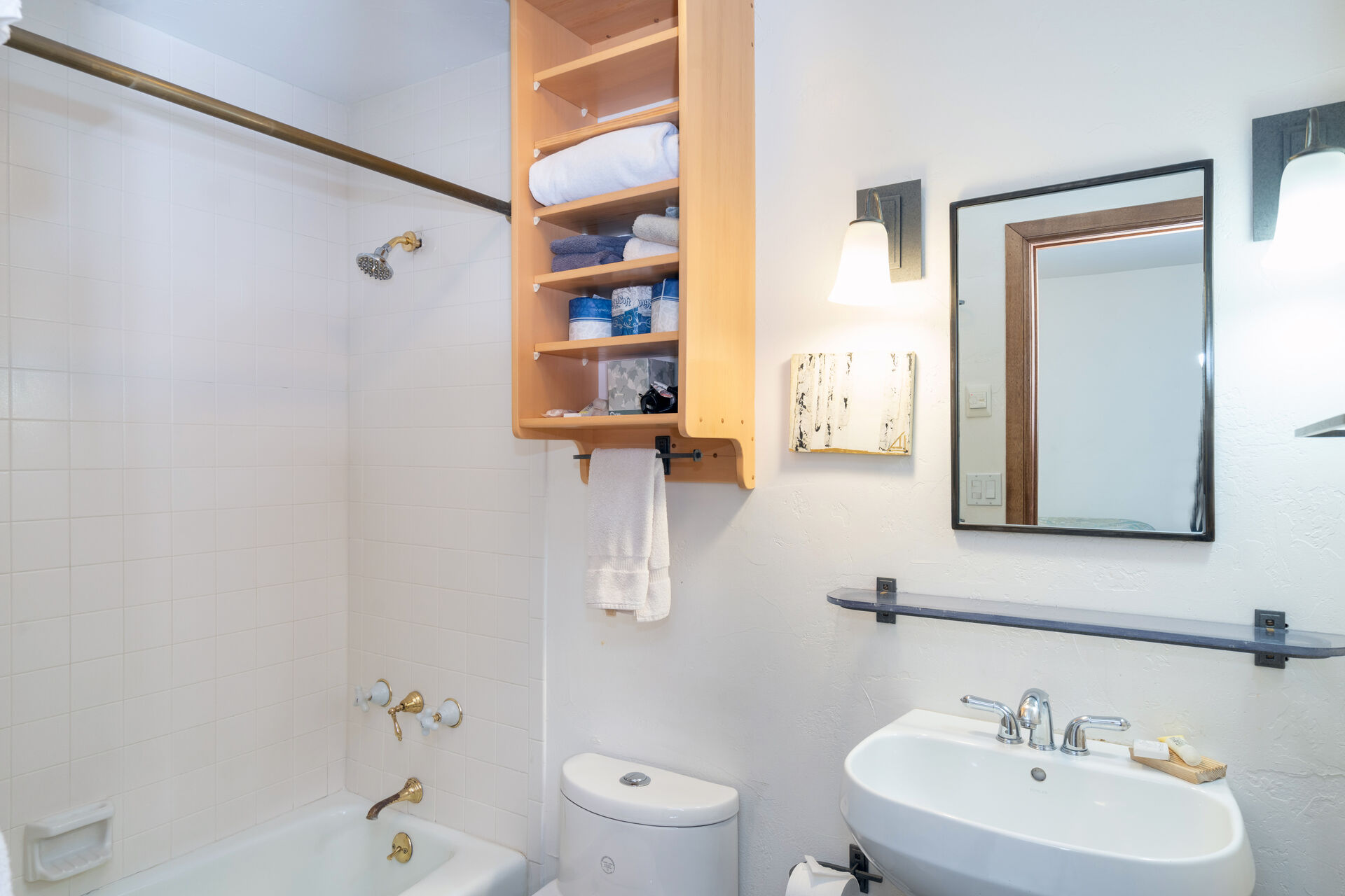 Bathroom with Pedestal Sink and Shower-Tub Combo