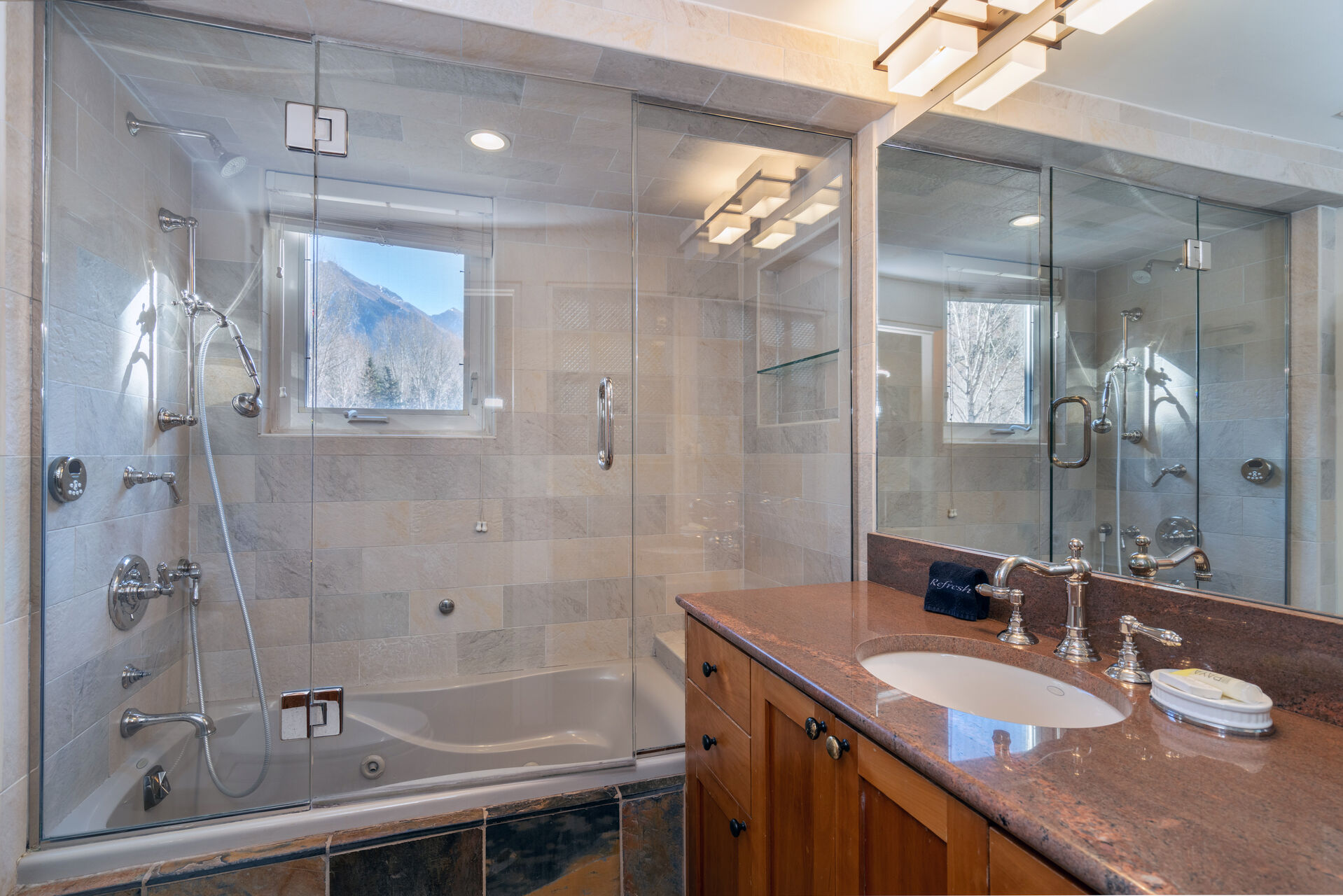 A walk in shower/tub and a sink