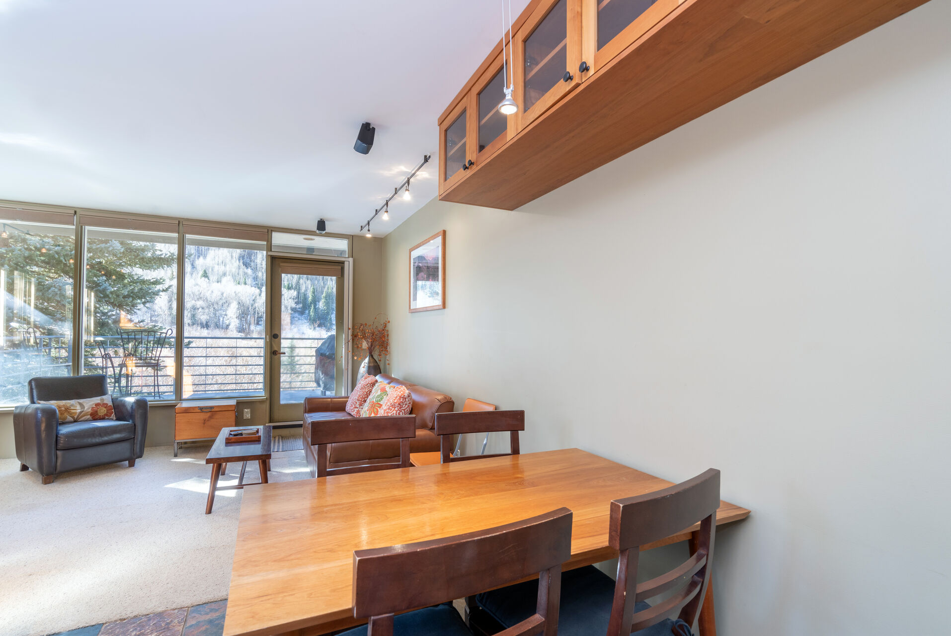 Dining area with a wooden table and seating for 4