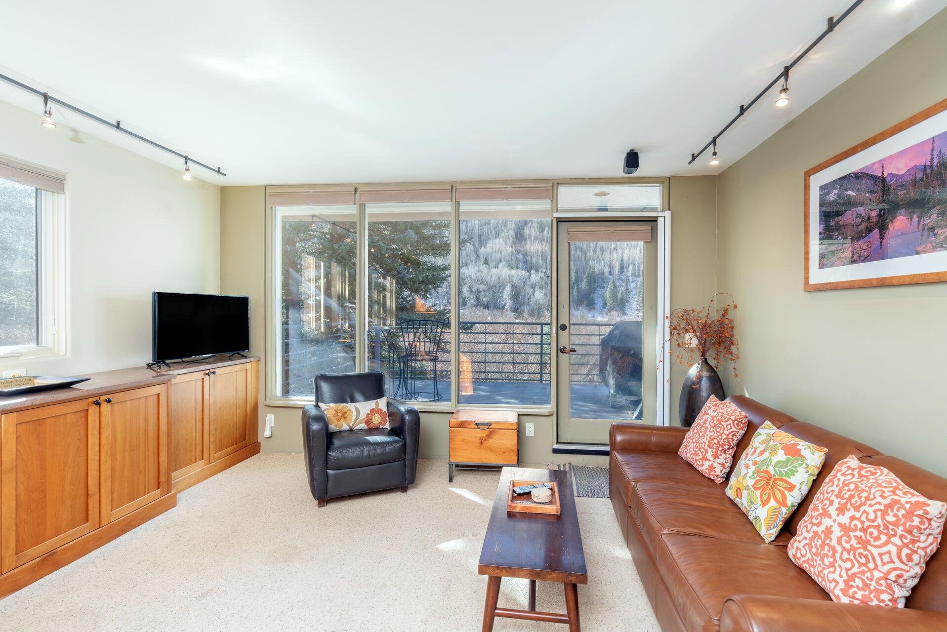 A sofa, chair, tv, a coffee table